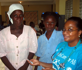 Nurse Myriam (right) with a clinic patient and her mother.
